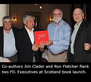 Jim Calder and Ron Fletcher with FIL Executives.